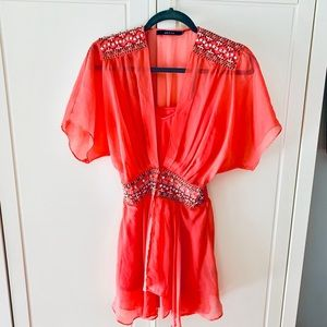 Lightweight, semi sheer, coral sequined top.